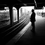 man-waiting-at-train-station